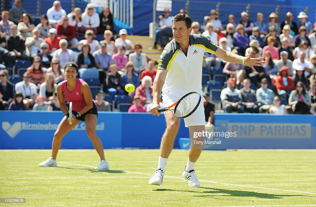Tim Henman and Heather Watson of Great Britain in action in their mixed doubles exhibition match against Greg Rusedski and Sorana Cirstea of Romania during day one of the AEGON Classic tennis tournament at Edgbaston Priory Club on June 9, 2013 in Birmingham, England.