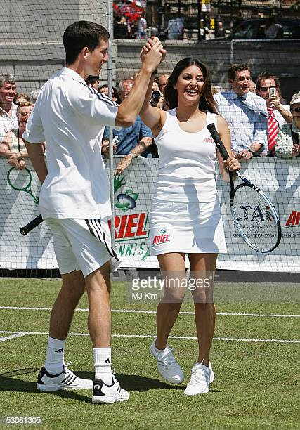 Tim Henman and Laila Rouass celebrated during the match at the Ariel Celebrity Tennis Match held in Trafalgar Square on June 13 2005 in London England