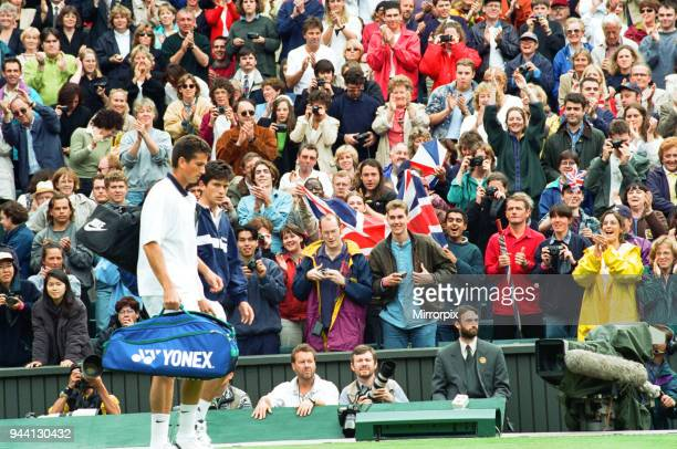 Tim Henman and Richard Krajicek walk onto the Wimbledon Centre Court to huge applause for the Fourth Round Match of the Mens Singles Tim Henman won...