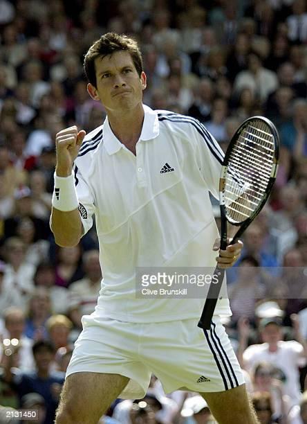 Tim Henman of Great Britain celebrates winning the match against Sebastien Grosjean of France during the men's quarter finals at the Wimbledon Tennis...