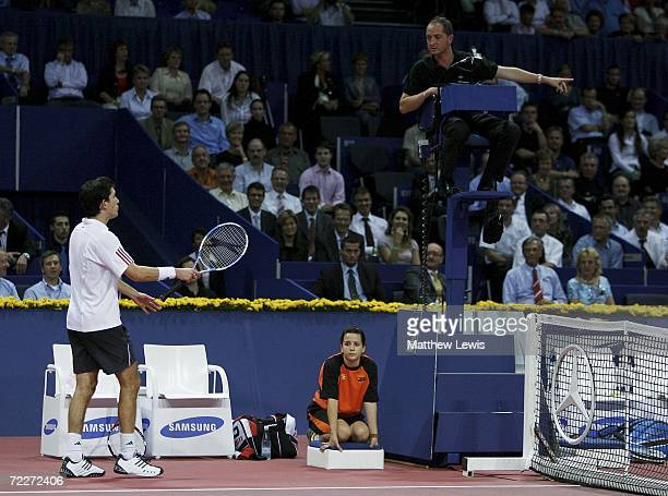 Tim Henman of Great Britain has a word with the umpire after a late call during his game against Stanislas Wawrinka of Switzerland during the ATP...