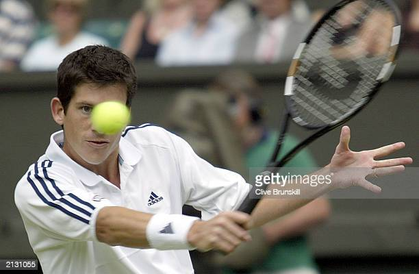 Tim Henman of Great Britain in action against Sebastien Grosjean of France during the men's quarter finals at the Wimbledon Tennis Championships at...