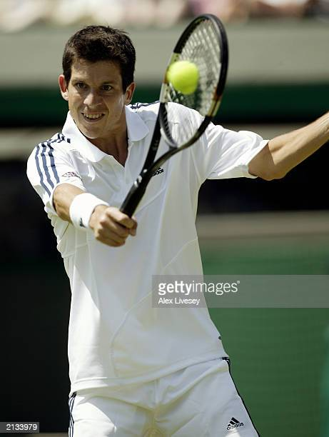Tim Henman of Great Britain in action against Tomas Zib of the Czech Republic during day two of the Wimbledon Lawn Tennis Championships held on June...