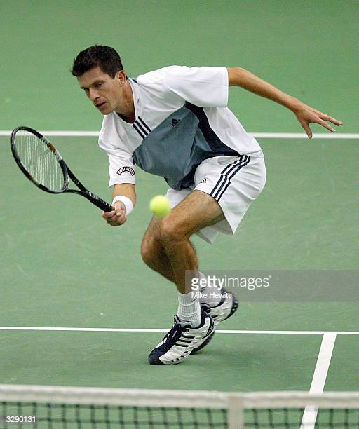 Tim Henman of Great Britain in action during his match against Gilles Kremer of Luxembourg during the Davis Cup Quarterfinal tie between Luxembourg...