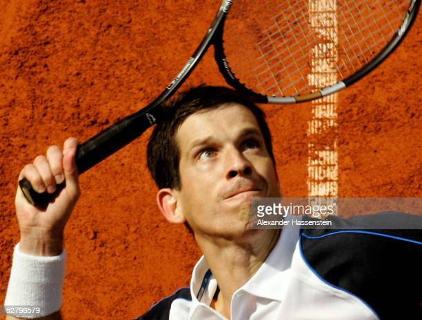 Tim Henman of Great Britain in action during his match against Greg Rudseski of Great Britain during the Masters Series Hamburg at Rothenbaum on May...
