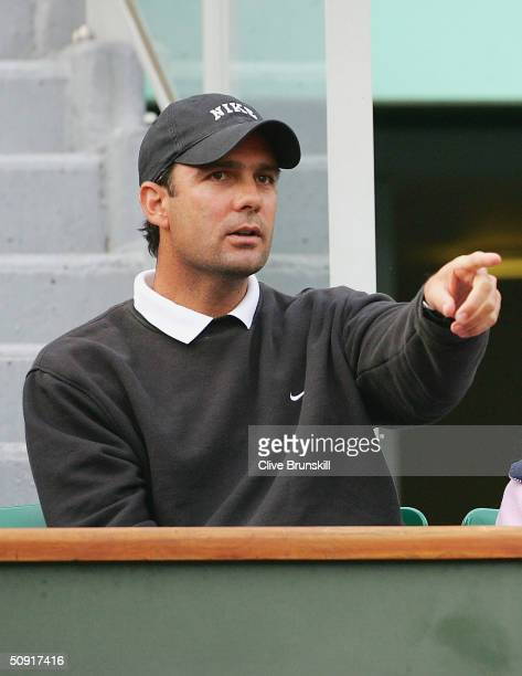 Tim Henman of Great Britain is watched by coach Paul Annacone in his quarter final match against Juan Ignacio Chela of Argentina during Day Nine of...