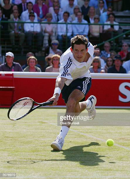 Tim Henman of Great Britain plays a forehand during his match against Anthony Dupuis of France during the QuarterFinals of the Stella Artois...