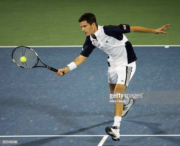 Tim Henman of Great Britain plays a volley during his quarterfinal match against Ivan Ljubicic of Croatia at the Dubai Duty Free Men's Open Tennis...