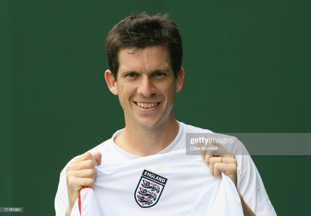 Tim Henman of Great Britain poses with an England football shirt during the Stella Artois Championships at Queen's Club on June 13, 2006 in London, Engand.