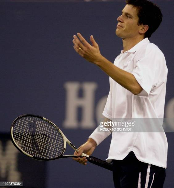Tim Henman of Great Britain reacts to loosing a point in his match against Richard Krajicek of the Netherlands at the US Open Tennis Tournament in...