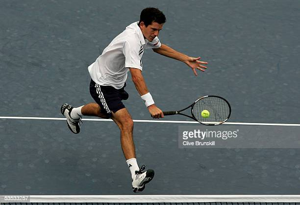 Tim Henman of Great Britain returns a bakhand at the net to Fernando Verdasco of Spain during the first round of the US Open at the USTA National...