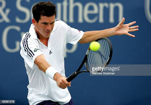 Tim Henman of Great Britain returns a shot to Nicolas Massu of Chile during the Western and Southern Financial Group Masters August 15, 2005 the...