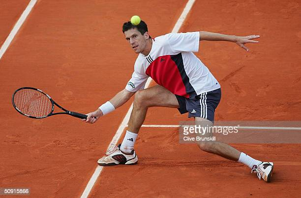 Tim Henman of Great Britain returns in his quarterfinal match against Juan Ignacio Chela of Argentina during Day Nine of the 2004 French Open Tennis...