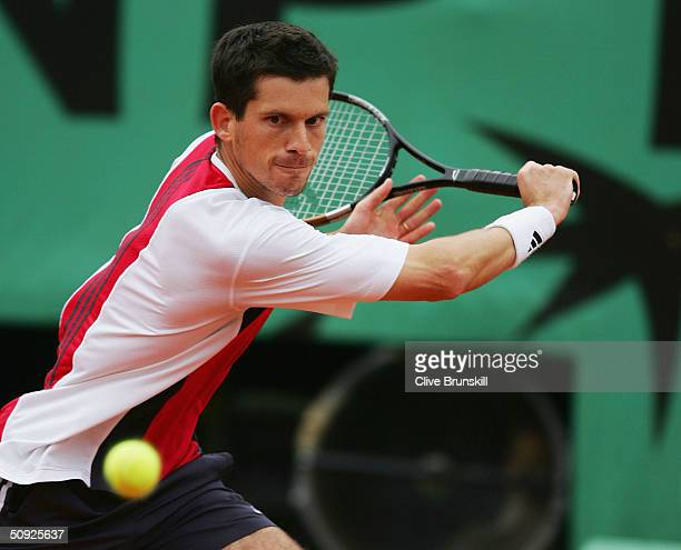 Tim Henman of Great Britain returns in his semi-final match against Guillermo Coria of Argentina during Day Twelve of the 2004 French Open Tennis...