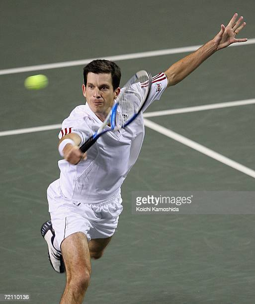 Tim Henman of Great Britain returns the ball against Hyung-Taik Lee of Korea during the Men's Singles Semifinal match of AIG Japan Open Tennis...
