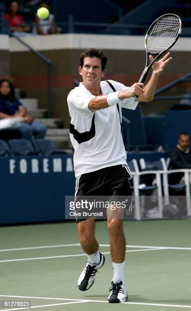 Tim Henman of Great Britain returns to Dominik Hrbaty of Slovakia during the US Open September 9 2004 at the USTA National Tennis Center in Flushing...
