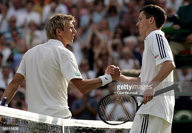 Tim Henman of Great Britain shakes hands with Jarkko Nieminen of Finland after Henman goes through in five sets after their first round match at the...