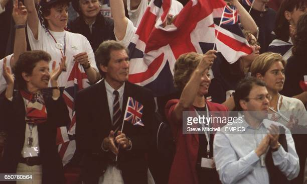 Tim Henman's family cheer him onto victory over Todd Martin LR Mrs Henman Mr Henman his girlfriend's mother Mrs Heald and his girlfriend Lucy Heald