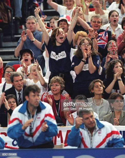 Tim Henman's father Anthony and his girlfriend Lucy Heald watch as Tim claims victory against Todd Martin during the final day of the Davis Cup at...