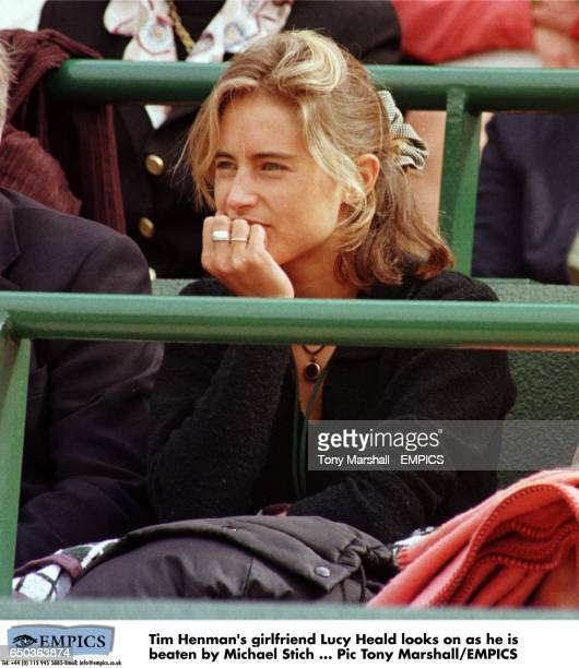 Tim Henman's girlfriend Lucy Heald looks on as he is beaten by Michael Stich