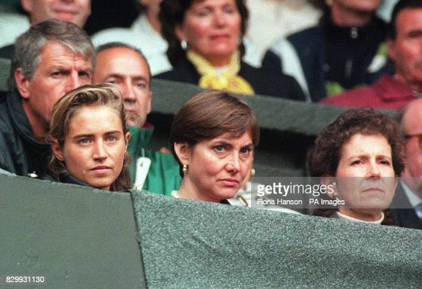 Tim Henman's girlfriend Lucy Heald sits with Henman's mother watching today's match against Jerome Golmard on Centre Court at Wimbledon Photo by...