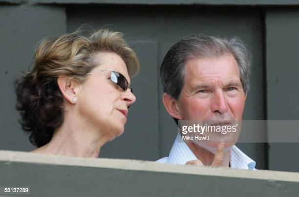 Tim Henman's mother and father watch on during his match against Dmitry Tursunov of Russia during the fourth day of the Wimbledon Lawn Tennis...