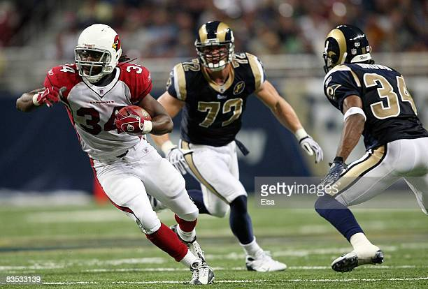 Tim Hightower of the Arizona Cardinals carries the ball and avoids Fakhir Brown and Chris Long of the St. Louis Rams on November 2, 2008 at the...
