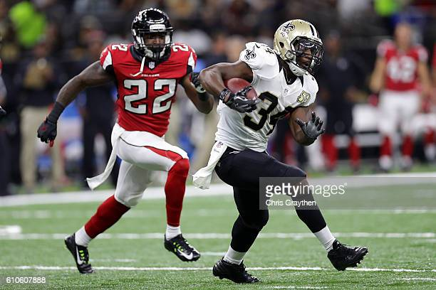 Tim Hightower of the New Orleans Saints avoids a tackle by Keanu Neal of the Atlanta Falcons at the MercedesBenz Superdome on September 26 2016 in...