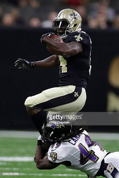 Tim Hightower of the New Orleans Saints is tackled by Kyle Juszczyk of the Baltimore Ravens at the MercedesBenz Superdome on September 1 2016 in New...