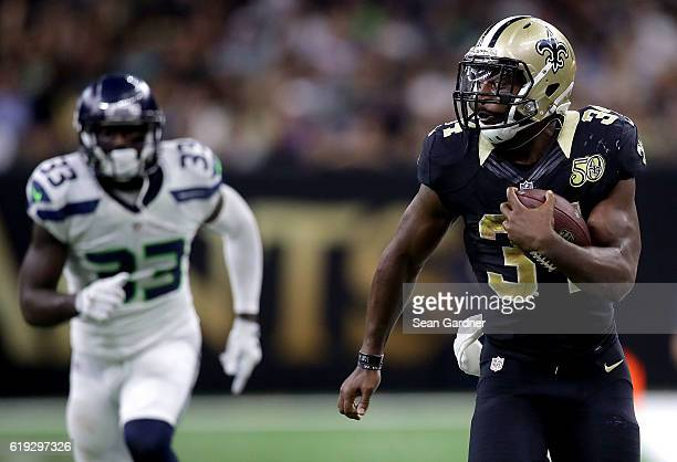 Tim Hightower of the New Orleans Saints runs for a first down past Kelcie McCray of the Seattle Seahawks druing the third quarter at the...
