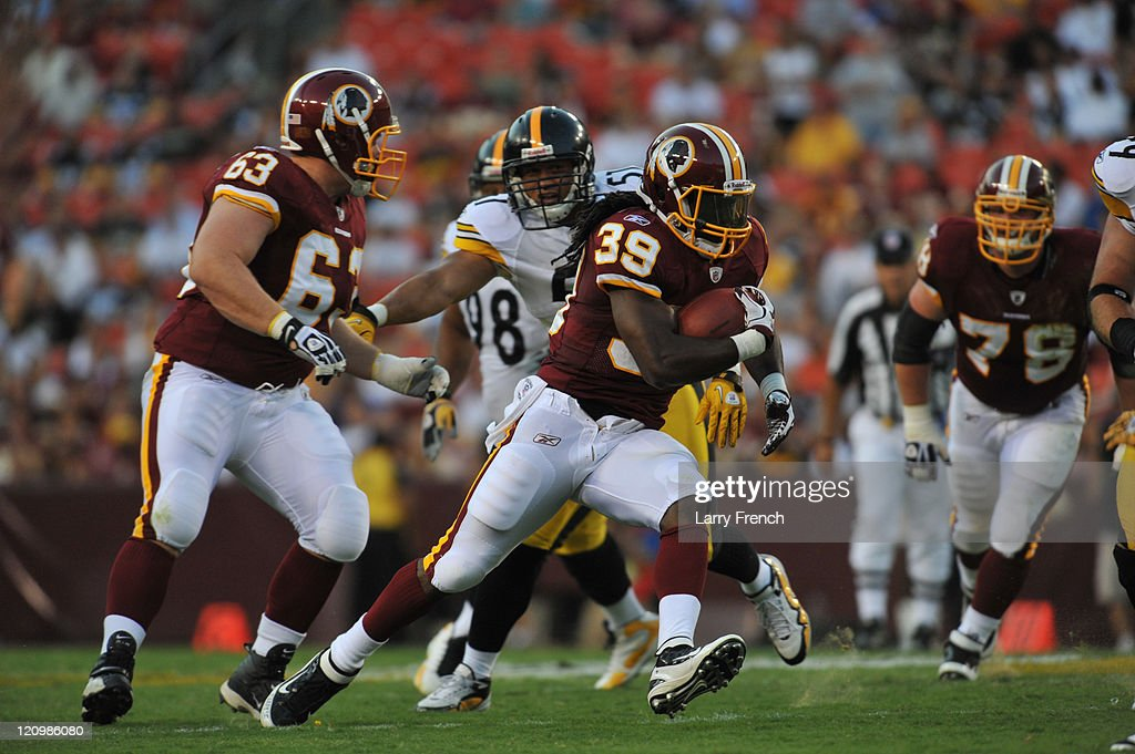 Tim Hightower #39 of the Washington Redskins runs the ball against the Pittsburgh Steelers at FedExField on August 12, 2011 in Landover, Maryland. The Redskins defeated the Steelers 16-7.