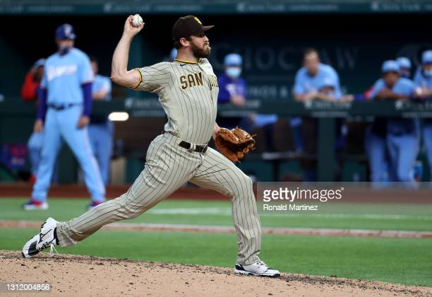 Tim Hill of the San Diego Padres throws against the Texas Rangers in the seventh inning at Globe Life Field on April 11, 2021 in Arlington, Texas.