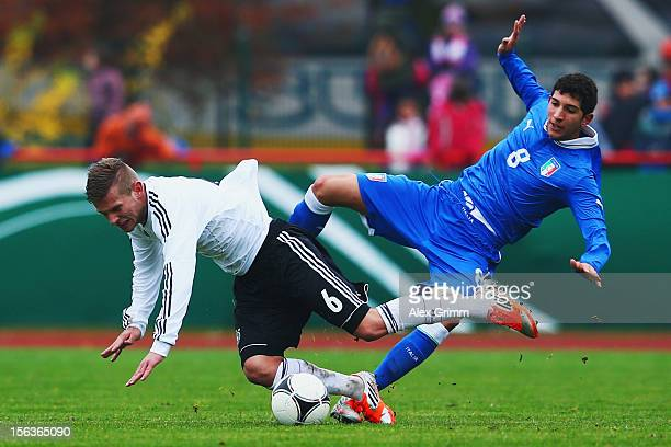 Tim Hoelscher of Germany is challenged by Luca Crecco of Italy during the U18 international friendly match between Germany and Italy at Sportpark on...