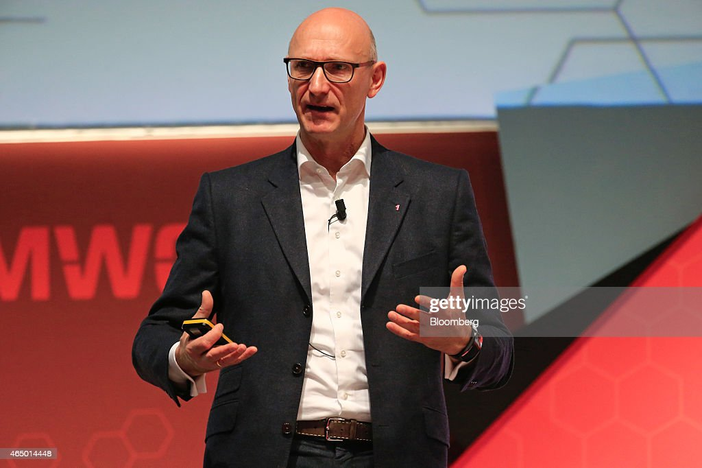Tim Hoettges, chief executive officer of Deutsche Telekom AG, gestures whilst speaking during a keynote session at the Mobile World Congress in Barcelona, Spain, on Monday, March 2, 2015. The event, which generates several hundred million euros in revenue for the city of Barcelona each year, also means the world for a week turns its attention back to Europe for the latest in technology, despite a lagging ecosystem. Photographer: Pau Barrena/Bloomberg via Getty Images