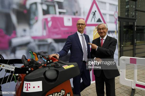 Tim Hoettges chief executive officer of Deutsche Telekom AG left and Ulrich Lehner chairman of Deutsche Telekom AG pose for a photograph beside a...