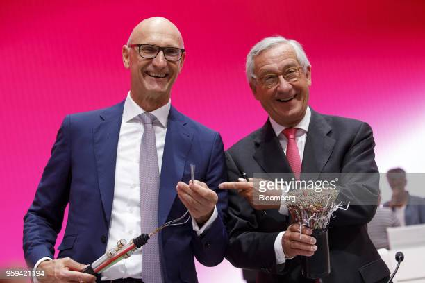 Tim Hoettges chief executive officer of Deutsche Telekom AG left and Ulrich Lehner chairman of Deutsche Telekom AG pose for photographers while...