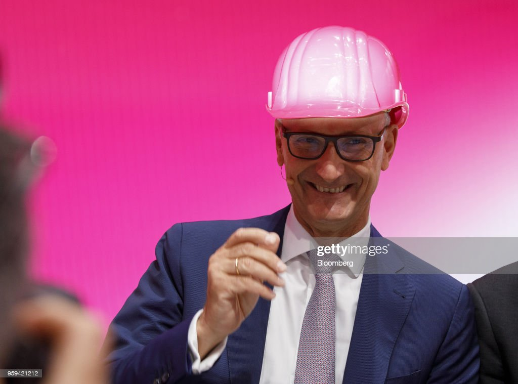 Tim Hoettges, chief executive officer of Deutsche Telekom AG, reacts while wearing a hardhat during the company's shareholders' meeting in Bonn, Germany, on Thursday, May 17, 2018. Deutsche Telekom and Daimler AG agreed to settle a 14-year-old arbitration case with the German government over the countrys truck toll system with a cash payment of 1.1 billion euros, the Transport Ministry said in a statement. Photographer: Alex Kraus/Bloomberg via Getty Images