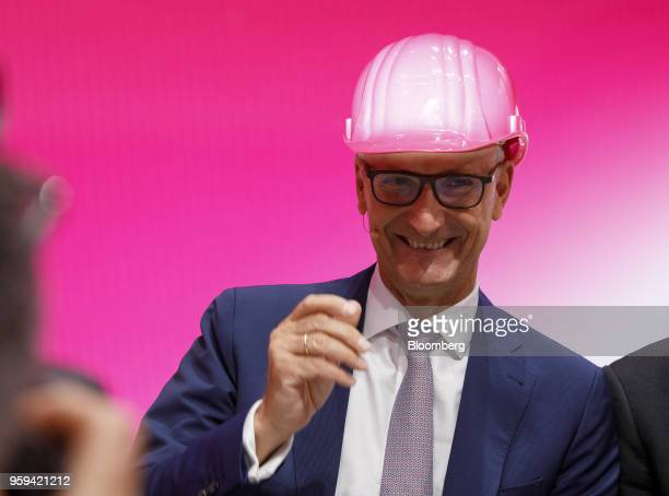 Tim Hoettges chief executive officer of Deutsche Telekom AG reacts while wearing a hardhat during the company's shareholders' meeting in Bonn Germany...