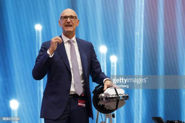 Tim Hoettges chief executive officer of Deutsche Telekom AG speaks beside fiber cable splicing machine during the company's shareholders' meeting in...
