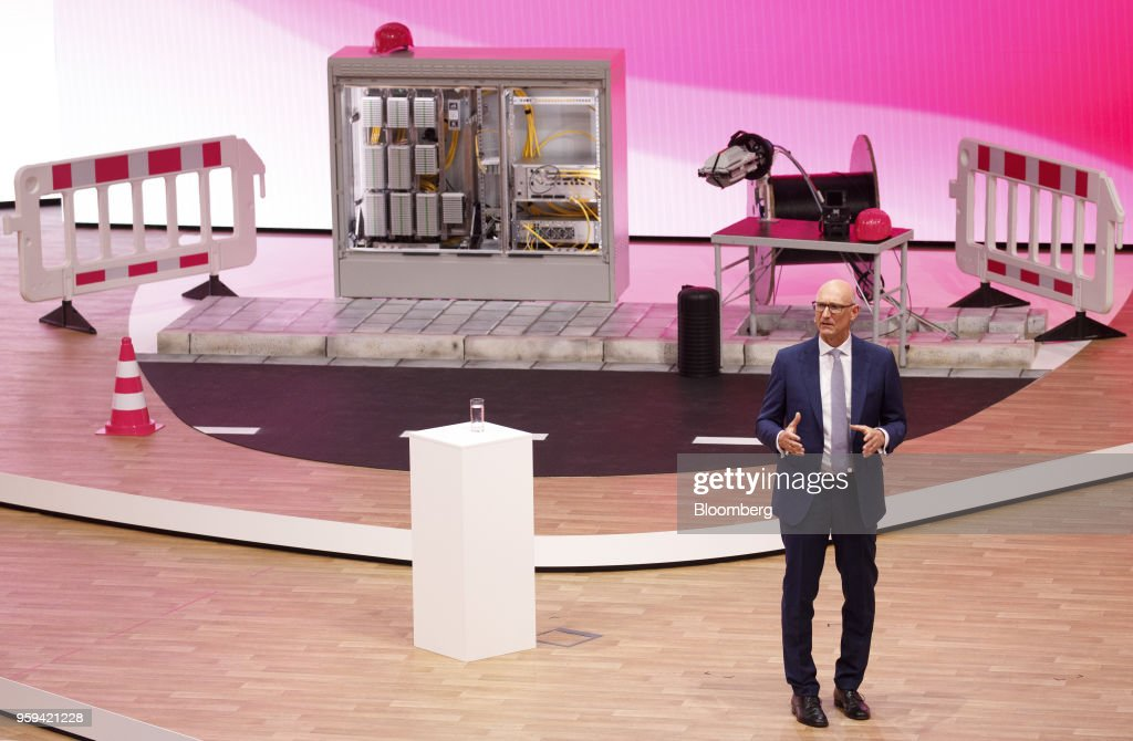 Tim Hoettges, chief executive officer of Deutsche Telekom AG, speaks beside construction materials and a multifunction primary connection point box during the company's shareholders' meeting in Bonn, Germany, on Thursday, May 17, 2018. Deutsche Telekom and Daimler AG agreed to settle a 14-year-old arbitration case with the German government over the countrys truck toll system with a cash payment of 1.1 billion euros, the Transport Ministry said in a statement. Photographer: Alex Kraus/Bloomberg via Getty Images
