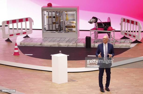 Tim Hoettges chief executive officer of Deutsche Telekom AG speaks beside construction materials and a multifunction primary connection point box...