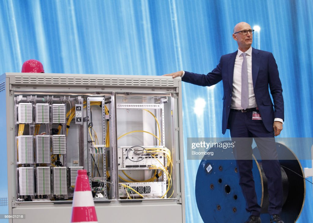 Tim Hoettges, chief executive officer of Deutsche Telekom AG, stands beside construction materials and a multifunction primary connection point box during the company's shareholders' meeting in Bonn, Germany, on Thursday, May 17, 2018. Deutsche Telekom and Daimler AG agreed to settle a 14-year-old arbitration case with the German government over the countrys truck toll system with a cash payment of 1.1 billion euros, the Transport Ministry said in a statement. Photographer: Alex Kraus/Bloomberg via Getty Images