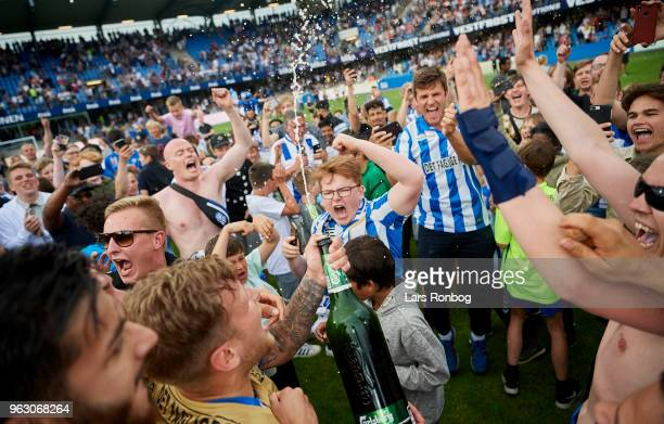 Tim Holscher of Esbjerg fB with the champagne celebrates after the Danish Alka Superliga Playoff match between Esbjerg fB and Silkeborg IF at Blue...
