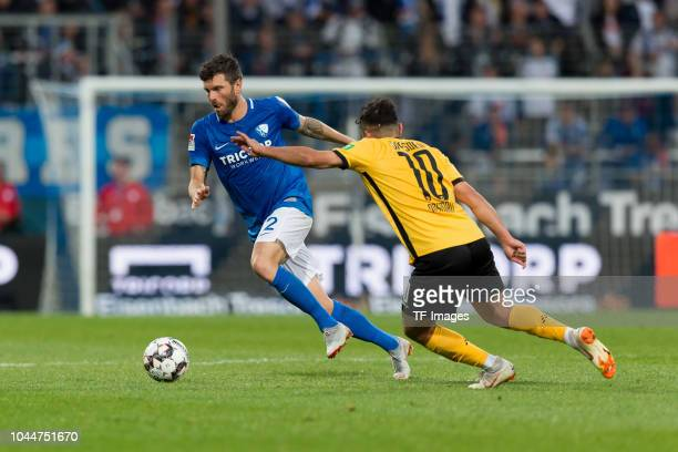 Tim Hoogland of Bochum and Aias Aosman of SG Dynamo Dresden battle for the ball during the Second Bundesliga match between VfL Bochum 1848 and SG...