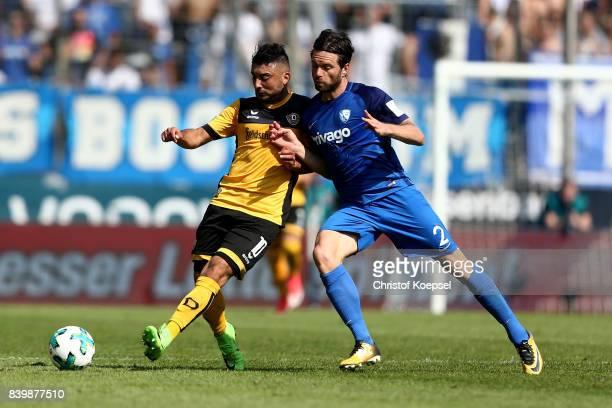 Tim Hoogland of Bochum challenges Aias Aosman of Dresden during the Second Bundesliga match between VfL Bochum 1848 and SG Dynamo Dresden at Vonovia...