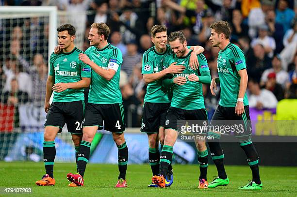 Tim Hoogland of Schalke is congratulated by teammates after scoring a goal to level the scores at 11 during the UEFA Champions League Round of 16...