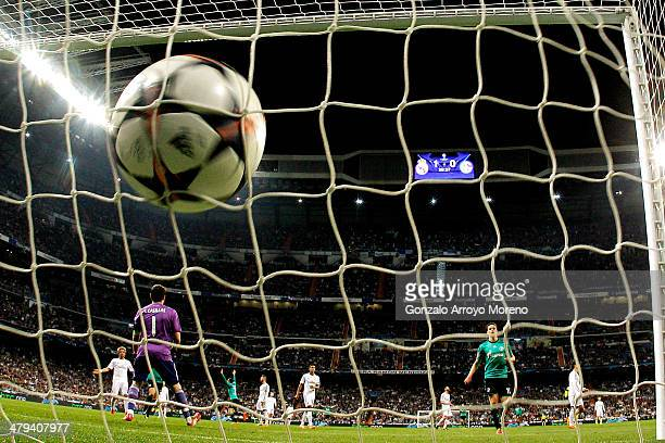 Tim Hoogland of Schalke turns away to celebrate after scoring a goal to level the scores at 11 past goalkeeper Iker Casillas of Real Madrid during...