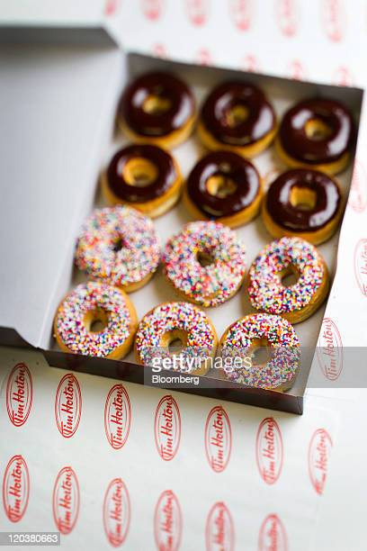 Tim Hortons Inc doughnuts are arranged for a photograph in Toronto Ontario Canada on Wednesday Aug 3 2011 Tim Hortons Inc is a chain of franchise...