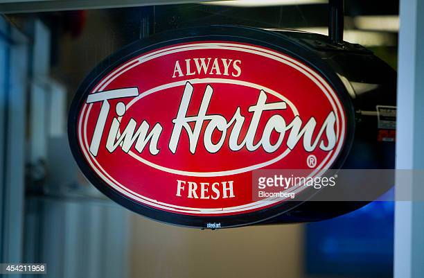 Tim Hortons Inc signage is displayed in the window of a restaurant in downtown Vancouver British Columbia Canada on Tuesday Aug 26 2014 Burger King...