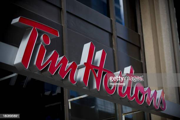 Tim Hortons Inc signage is displayed outside of a restaurant in Toronto Ontario Canada on Tuesday Sept 17 2013 Tim Hortons Inc Chief Executive...